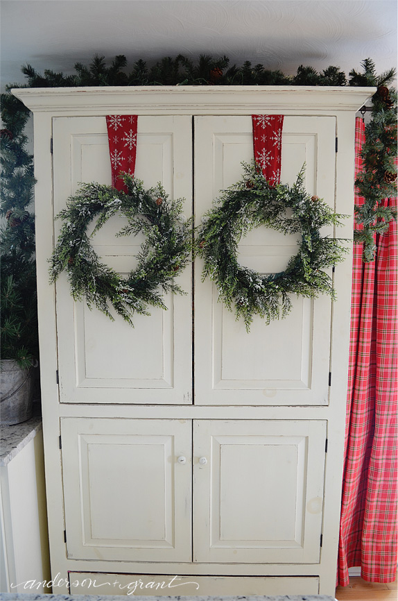 Decorate your cupboards by hanging a wreath on the doors! | www.andersonandgrant.com
