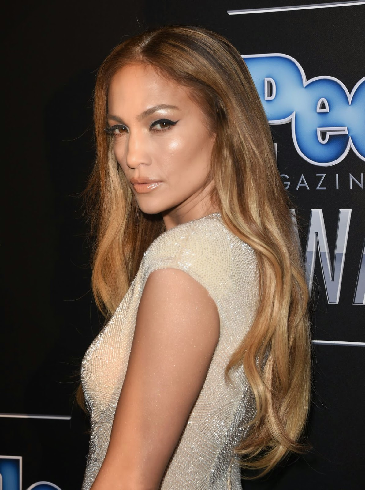 Jennifer Lopez wears a sexy plunging jumpsuit at the 2014