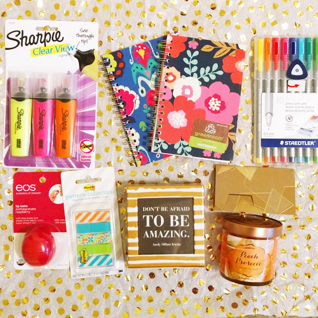 highlighters, notebooks, staedlter pens, eos pomegranate raspberry lip balm, post-it pattern flags, inspirational quote box, starbucks, peach prosecco candle.