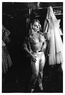 Candid shot of showgirl in dressing room