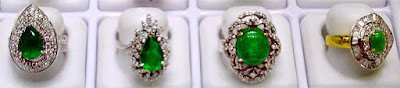 A range of high end jade gold and diamond engagement rings