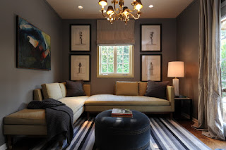 Simple Interior of the Living Room with Brown Modern Sofa Bed and Dark Table under Chandelier