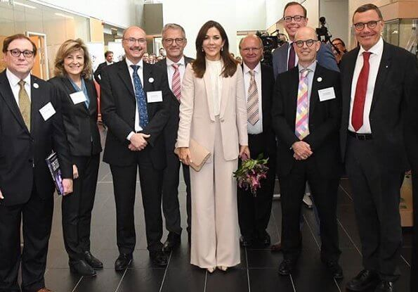Crown Princess Mary wore Andiata Cecel blazer and Gytta trousers and Gianvito Rossi python pumps. Naledi Copenhagen clutch
