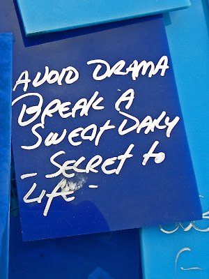"Sculpture graffiti: ""Avoid Drama Break a sweat daily--Secret to Life.""  White on Navy Blue."