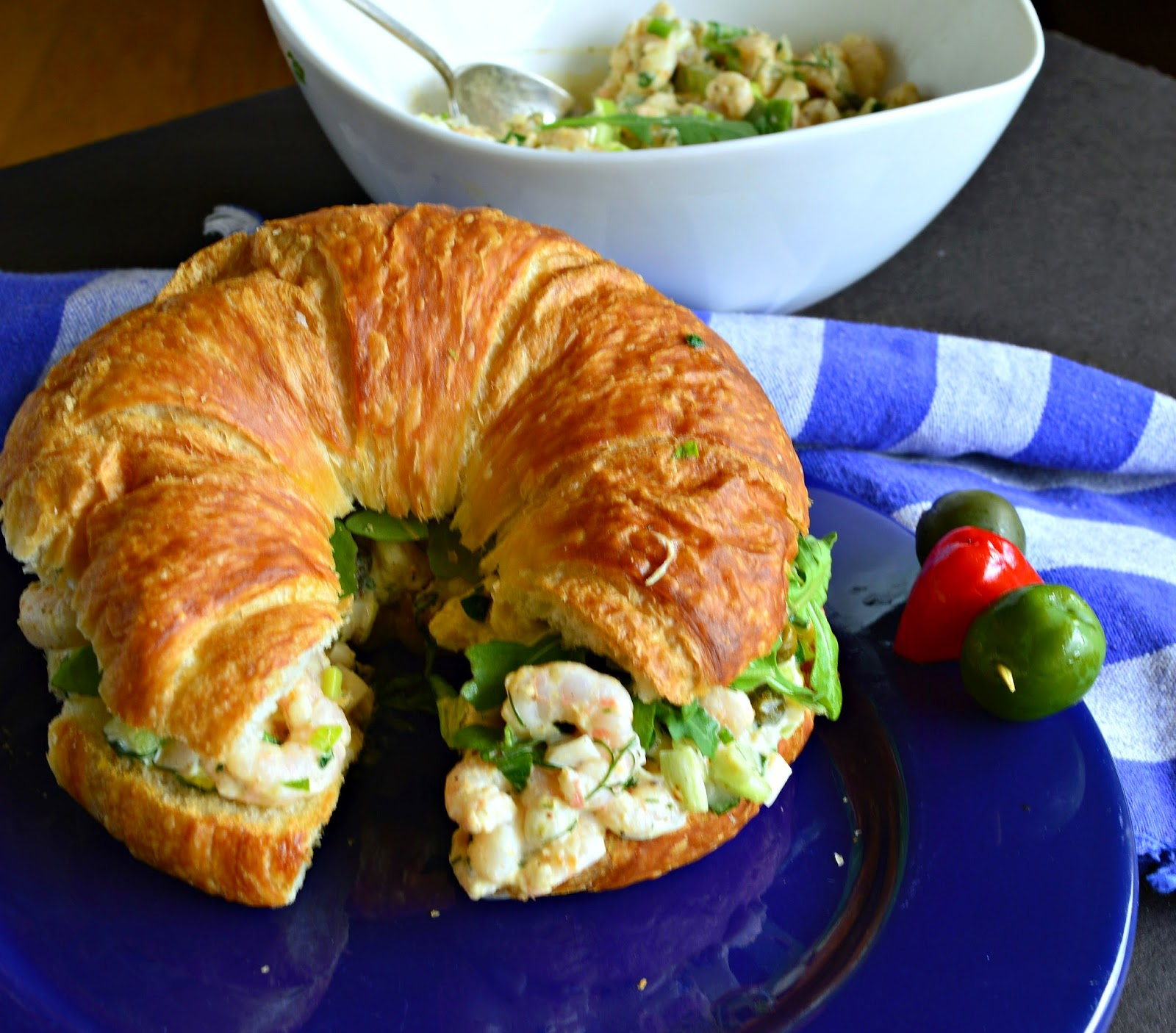 Shrimp Salad croissants are very special. Seasoned with Old Bay, capers and a few other things, these simple croissant sandwiches will make lunch, brunch or dinner special! #shrimp #croissants #sandwiches www.thisishowicook.com