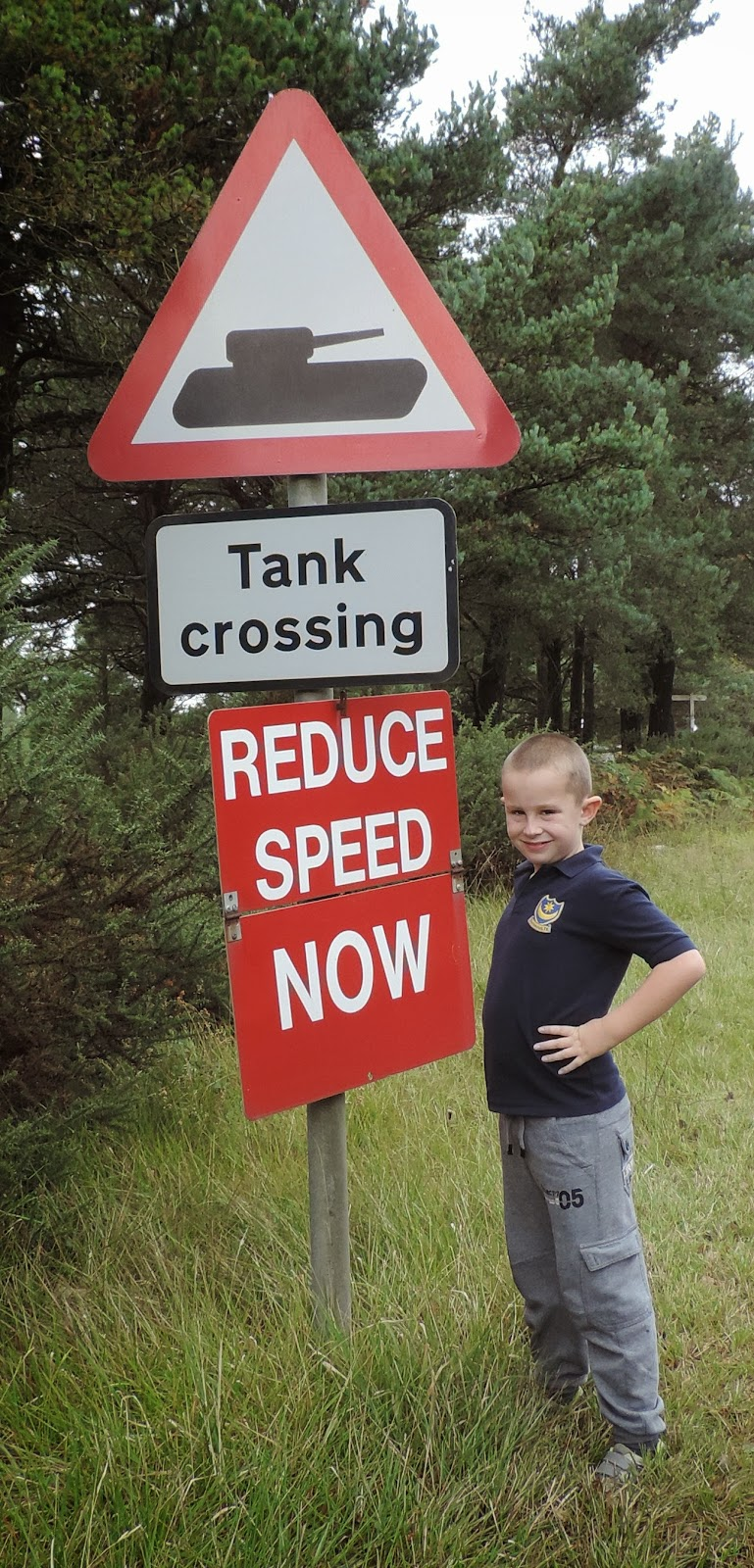 funny warning sign near tank museum bovington camp dorset
