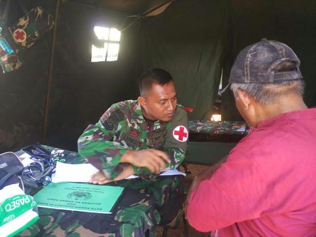 Yonif PR 328 Kostrad Berikan Bantuan Kesehatan Kepada Masyarakat