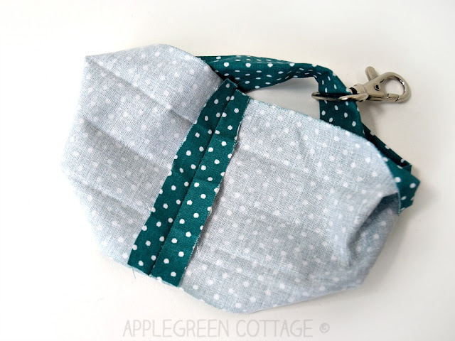 How to add a DIY wristlet strap to any bag you already have. Transform any zipper pouch into a grab-and-go clutch, using this easy beginner sewing tutorial. You'll love it!