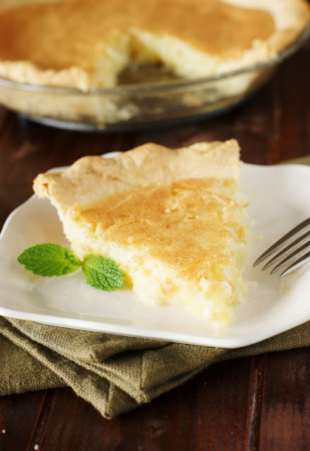 Classic Coconut Pie ~ coconut deliciousness surrounded in moist-and-creamy, melt-in-your-mouth vanilla custard.  And that is coconut goodness that just can't be beat!   www.thekitchenismyplayground.com