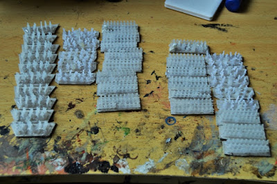 """Two unpainted """"Granny grating"""" armies"""
