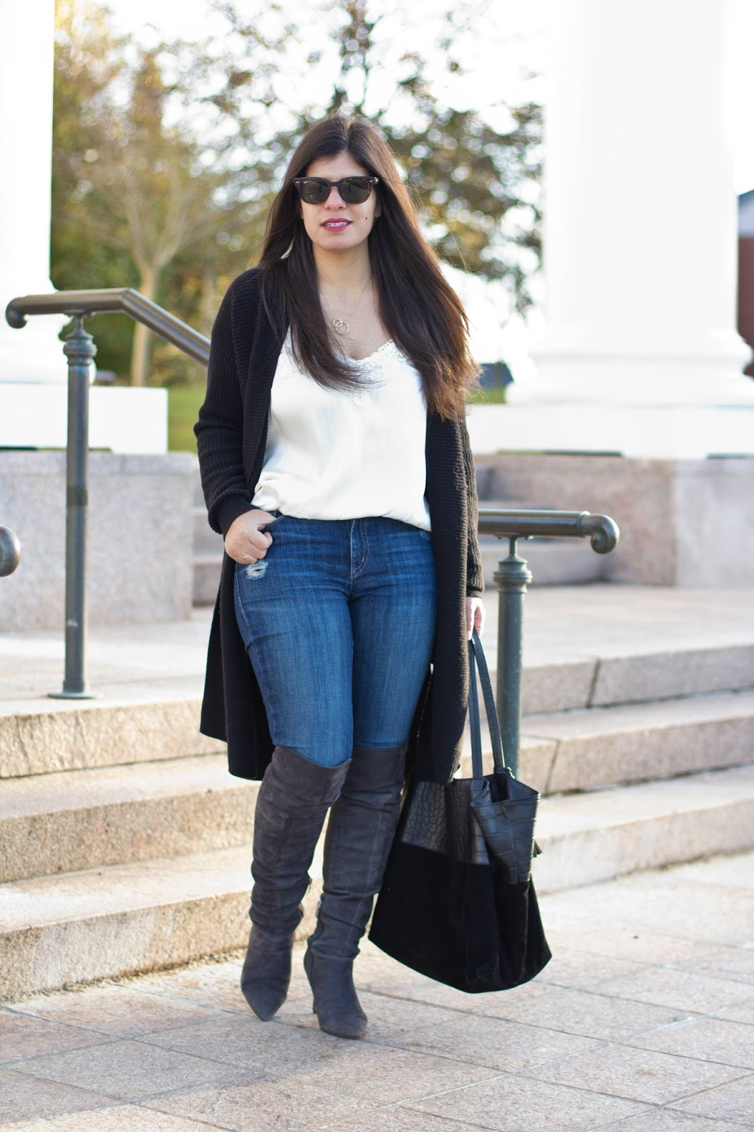 CT Fashion blogger wearing a long black gap cardigan, yoga jeans, lace cami, and grey over the knee boots for winter