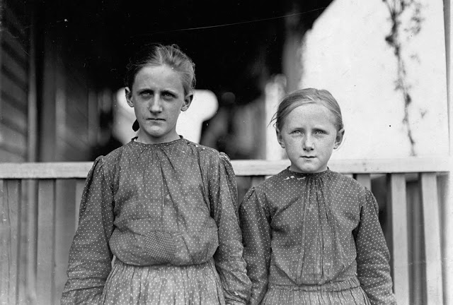 Minnie Carpenter, (left) photographed in November of 1908 at Loray Mill in Gastonia, North Carolina. Minnie makes fifty cents for a 10-hour day as a spinner in the mill. The younger girl works irregularly.