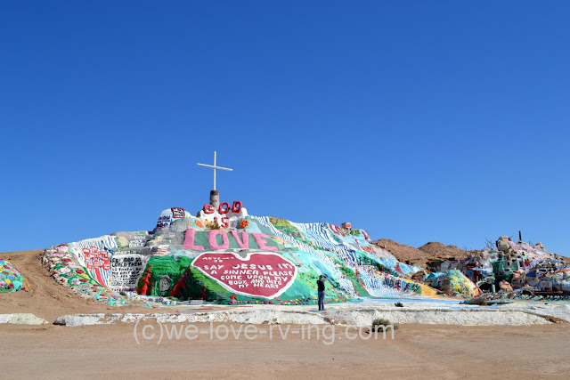 There are messages painted on the side of Salvation Mountain