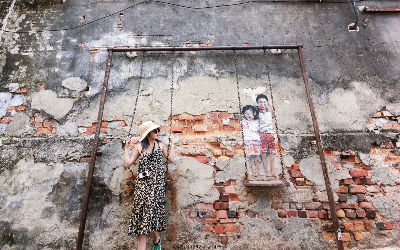 Brother and Sister on a Swing - Penang Street Art