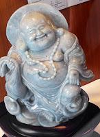 white laughing Buddha in a Yangon shop