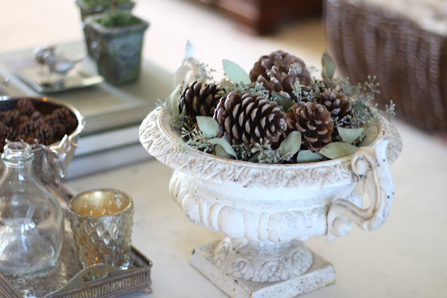 styling a coffee table antique urn pinecones eucalyptus christmas fall