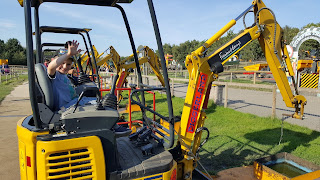 My first-born on a digger