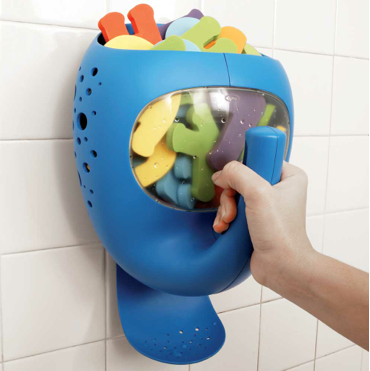wall-mounted pail for bath toys, shaped like a whale