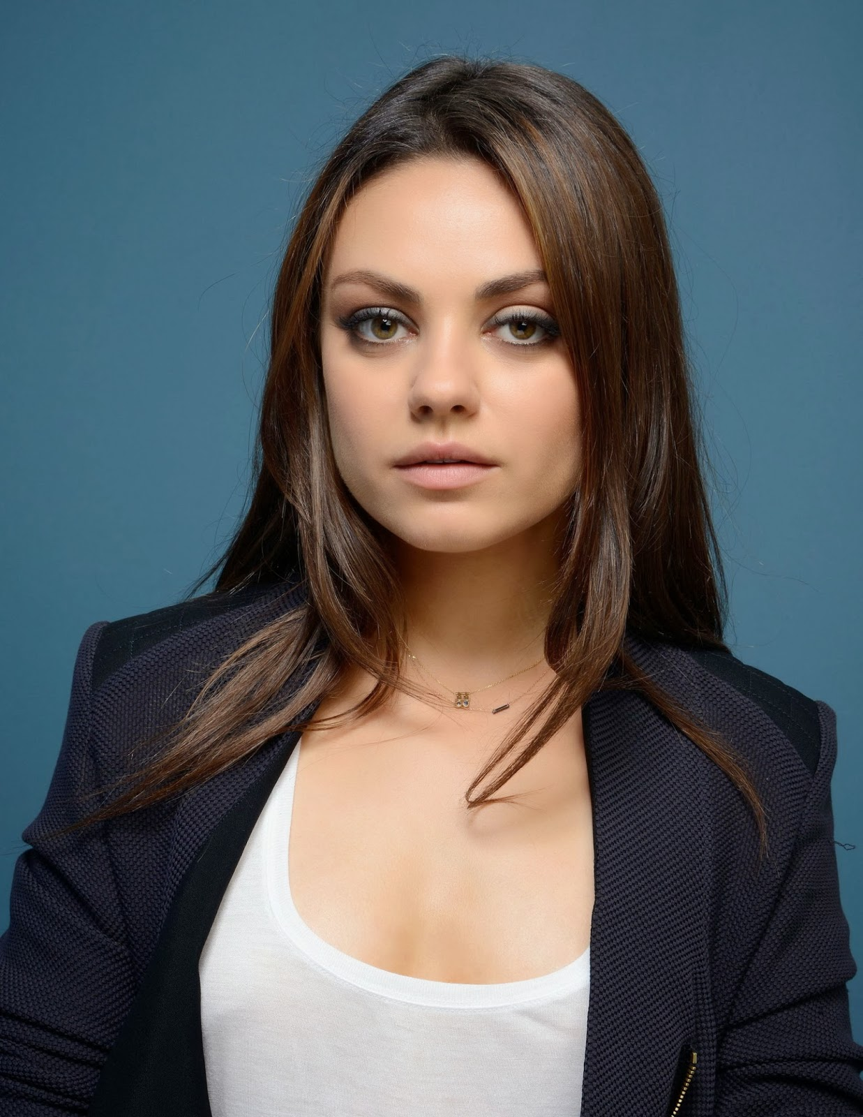 Mila Kunis Wearing a Suit and Showing Some Cleavage