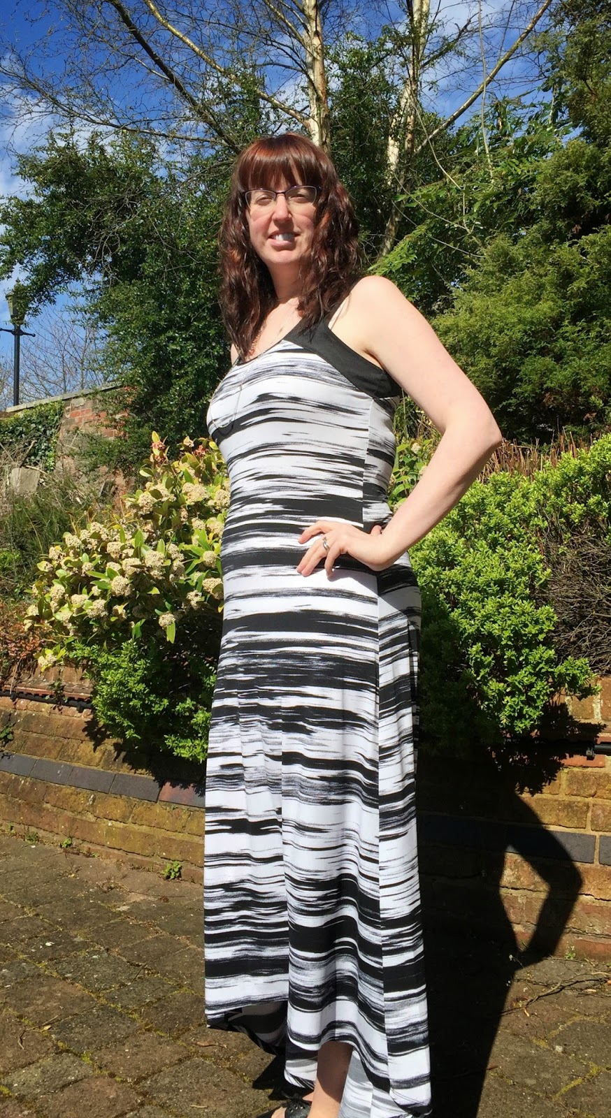 Morgan's Milieu | Episode Dip Hem Printed Maxi Dress Review: Morgan Prince wearing dim hem black and white maxi dress.