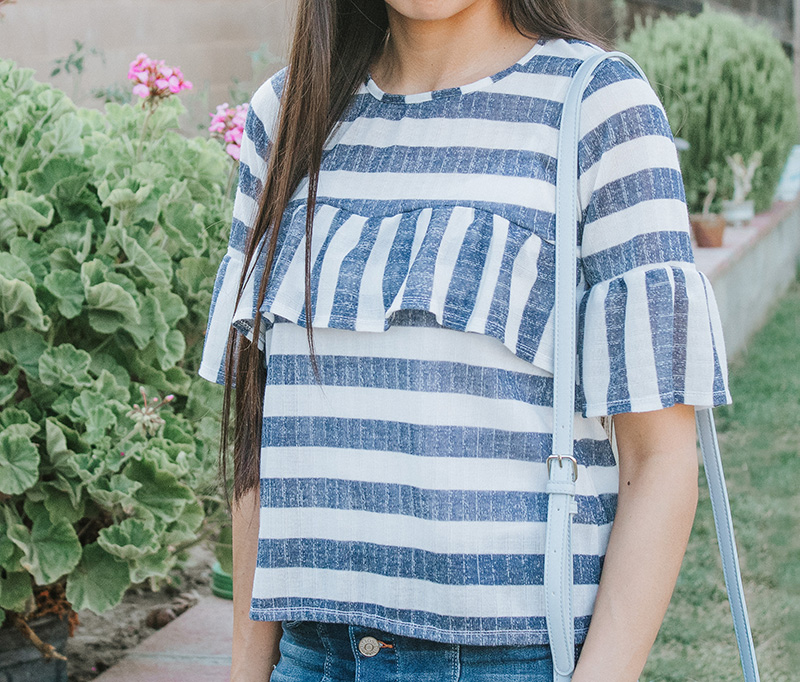 blue striped ruffle blouse with bell sleeves close up