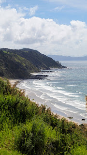 Views over the beach at Mangawhai Heads from the Goldschmidt Trail on the drive from Auckland to Paihia in the Bay of Islands New Zealand