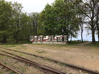 westerplatte sign beyond some train tracks