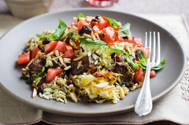 Curried lamb layered with saffron rice and fried onions makes for a biri Lamb biryani recipe
