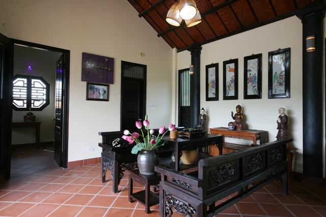 Không gian phòng khách với bộ bàn ghế trường kỷ gỗ đẹp