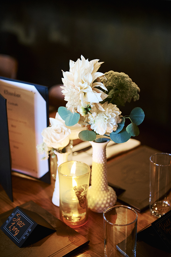 Milk glass bud vases from Bespoke Decor rentals, bud vase floral arrangements by Flower Factory