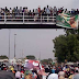 Thousands Crowd Pedestrian Bridge In Bauchi To Get A Glimpse Of Buhari's Convoy