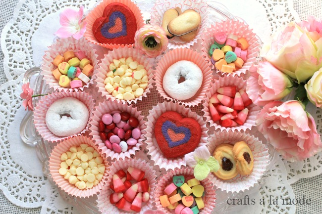cookies and pink candy in Valentine cupcake papers