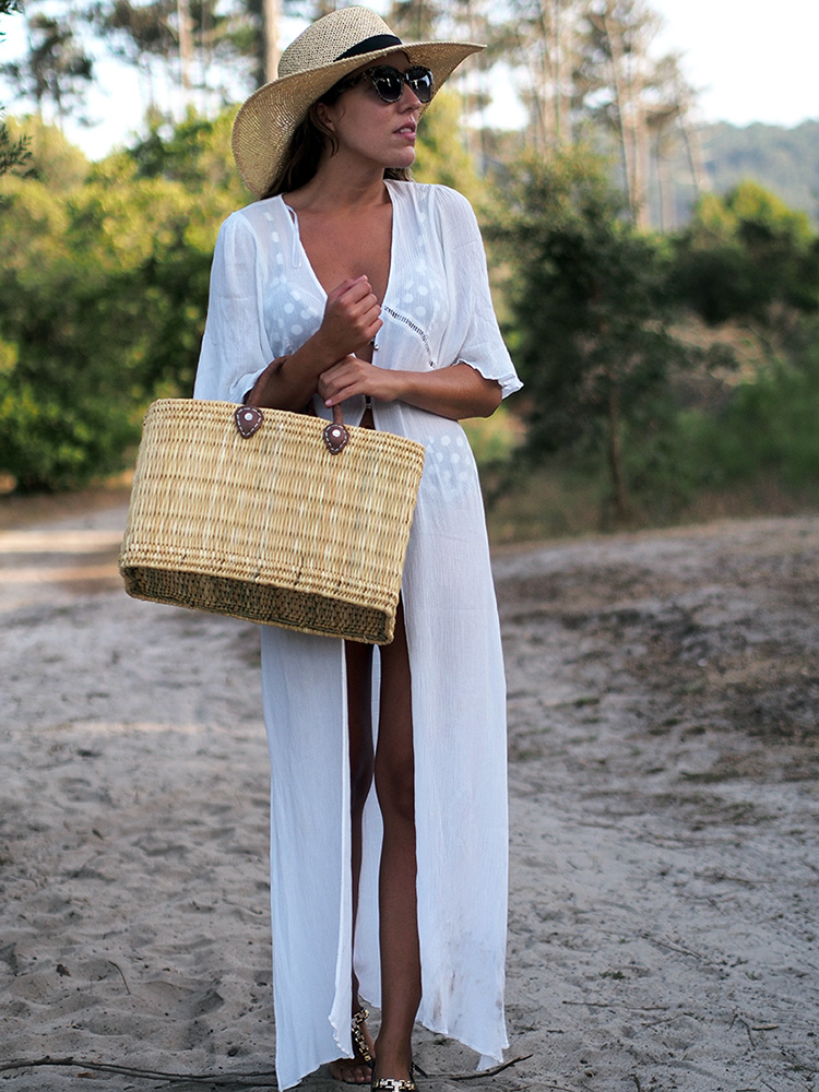 Beach style - polka dots bikini, straw bag and hat, white dress