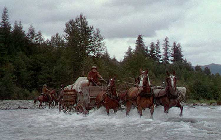The wagon train moves forward in Anthony Mann's Bend of the River.