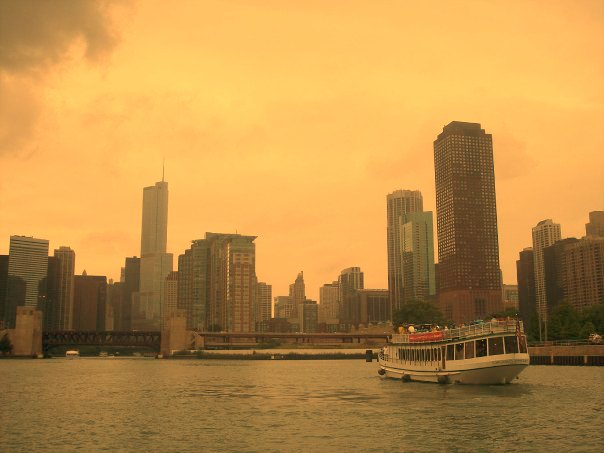Downtown Chicago boat on river and skyline with golden sky by Hello Lovely Studio