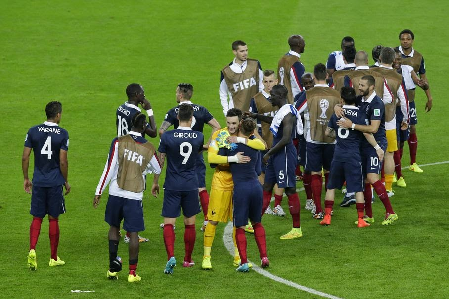 French players celebrate their 3-0 win after the group E World Cup soccer match between France and Honduras at the Estadio Beira-Rio in Porto Alegre, Brazil, Sunday, June 15, 2014.