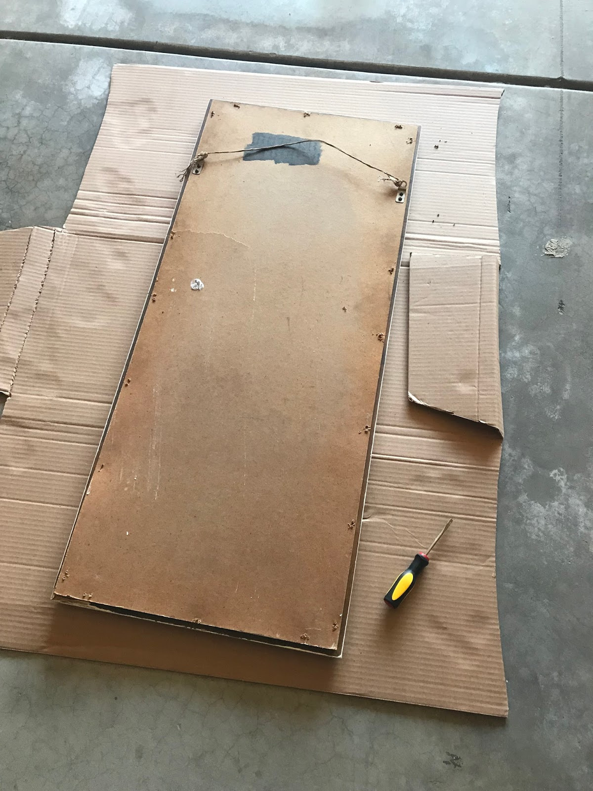 removing the back of the mirror