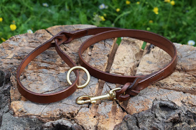 Leather leash with braided ends and solid brass snap-hook suitable for small and medium size dogs