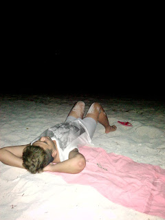 guy at the beach at night time