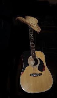 Bäkkäri ja kitara nurkkaan