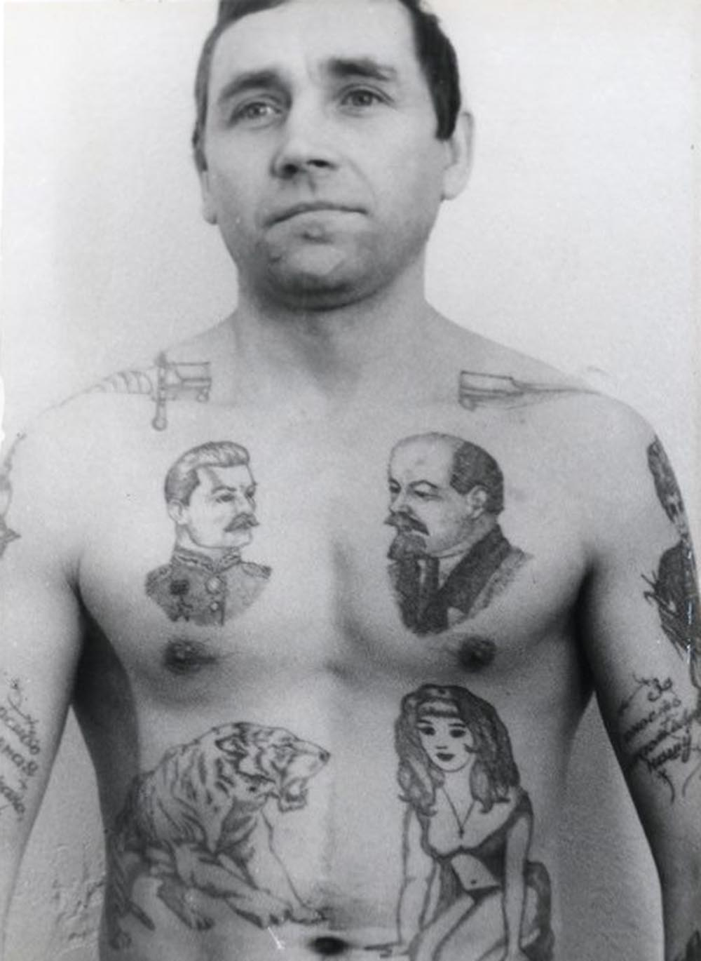 Text on the arm reads 'Thank you Dear Motherland for my ruined youth.' A dagger through the neck shows that a criminal has committed murder in prison and is available to hire for further killing. The drops of blood can signify the number of murders committed. Lenin is held by many criminals to be the chief 'pakhan' (boss) of the Communist Party. The letters BOP, which are sometimes tattooed under his image, carry a double meaning: The acronym stands for 'Leader of the October Revolution' but also spells the Russian word 'VOR' (thief).