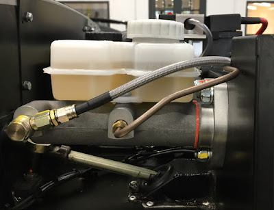 The upgraded A.P. Racing brake master cylinder