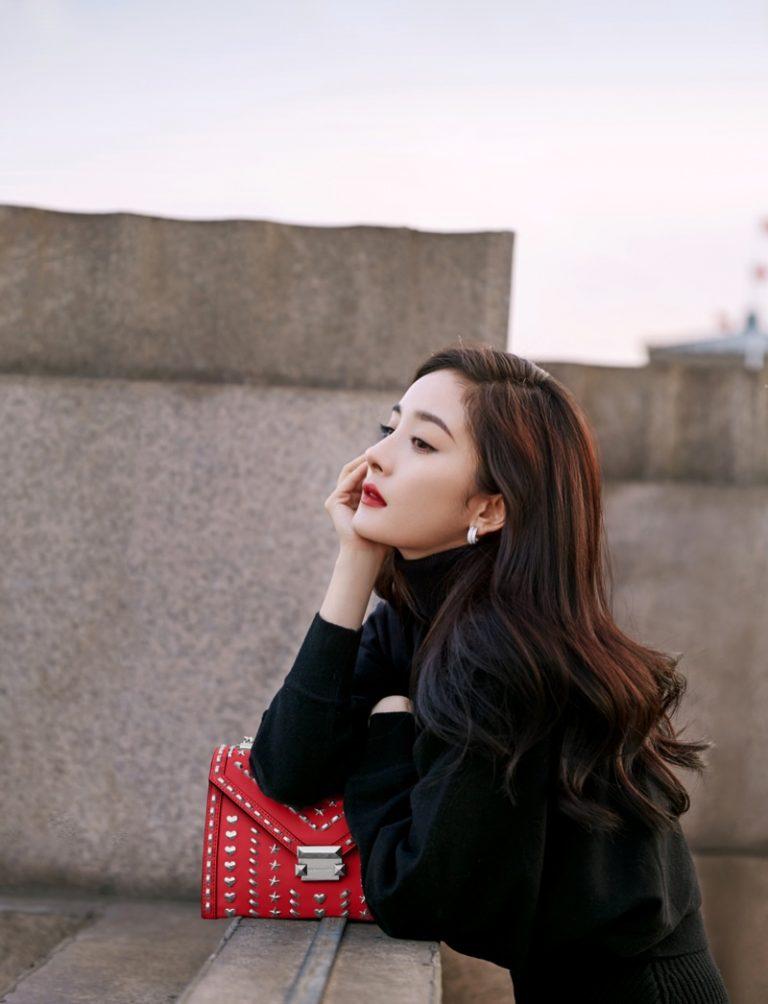 Yang Mi poses with Yang Mi x Michael Kors Whitney handbag