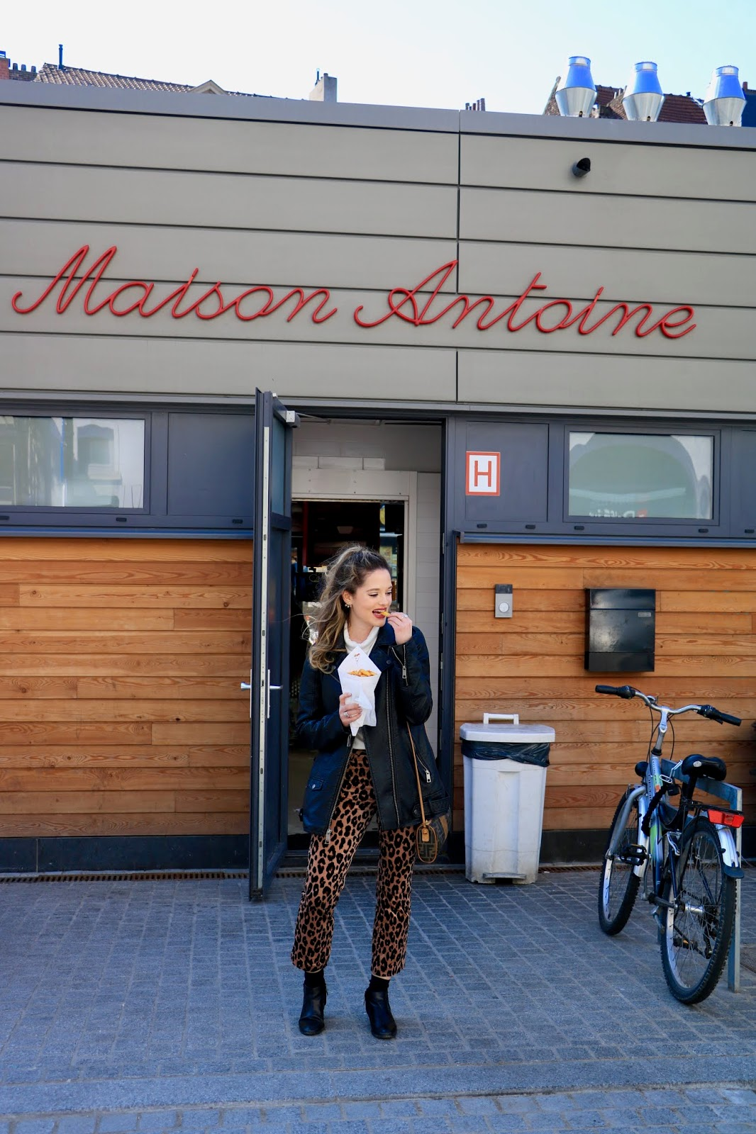 Food blogger Kathleen Harper eating the best fries in Belgium from Maison Antoine in Brussels