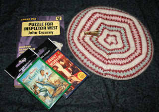 Prizes in my giveaway: a fair isle beret, two fridge magnets, a John Creasey crime novel, a rocket brooch and a Soviet nuclear scientist's lapel pin.