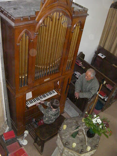 boy playing church organ