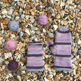 One and half striped knitted mittens