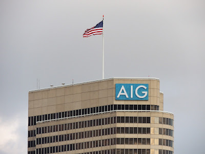 AIG signage and flag atop office tower on Allen Parkway