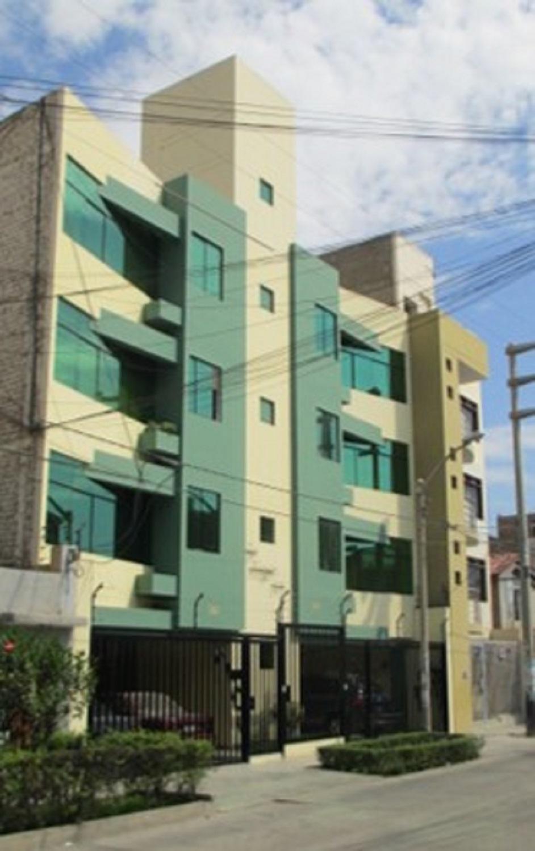 Fachadas de casas casa multifamiliar de cuatro pisos for Pisos para fachadas de casas