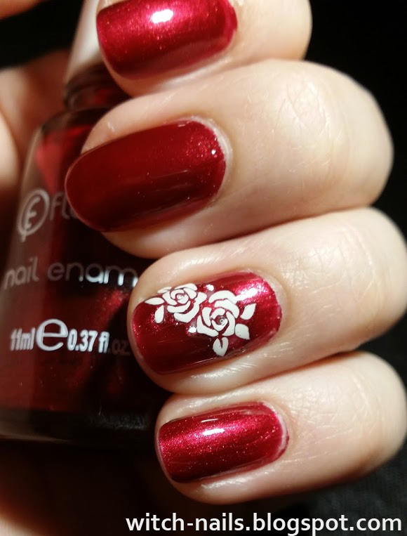 metallic dark red manicure with white flowers
